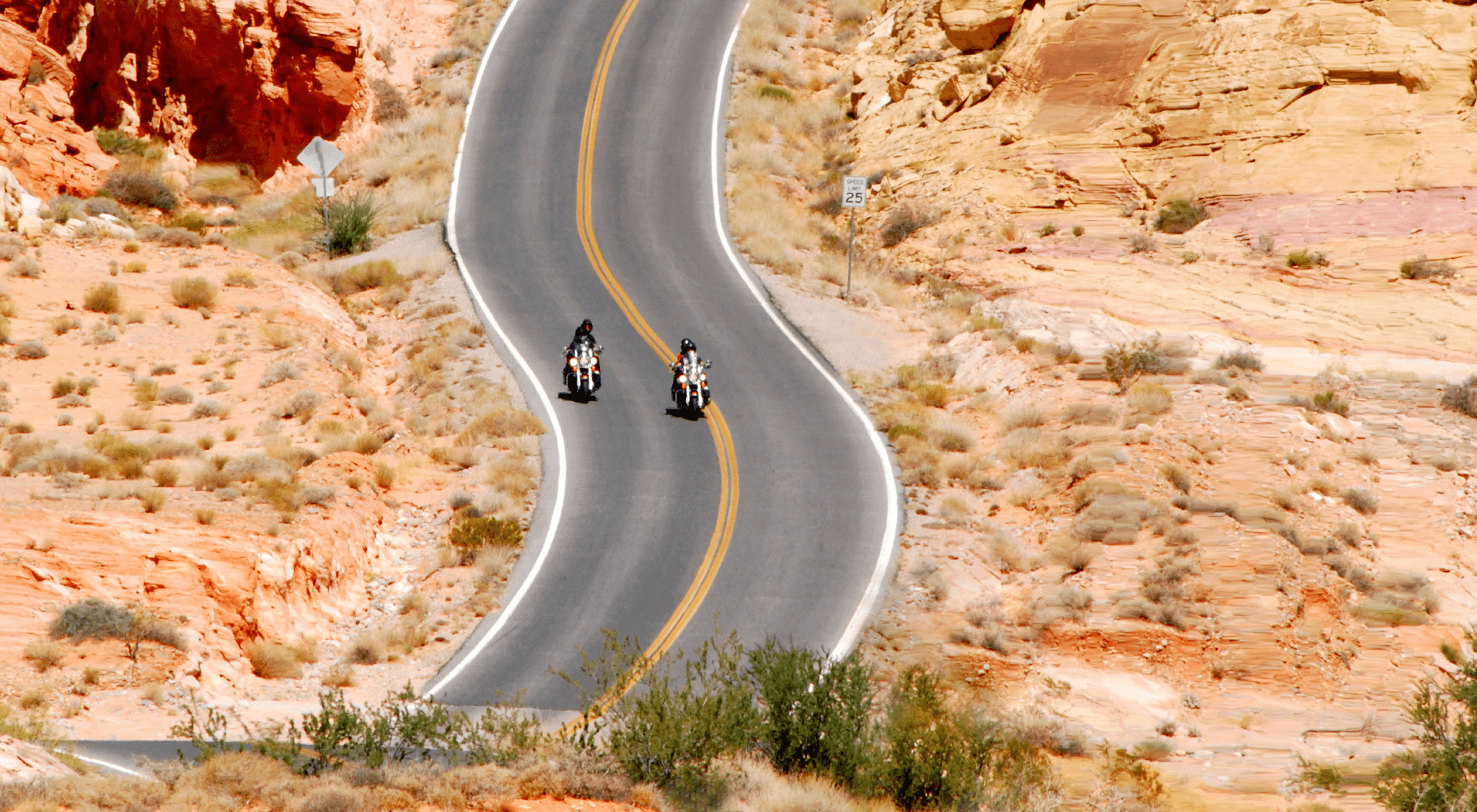 motorcycles on curving road